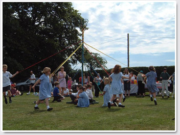 Maypole dancing at the Village Fete